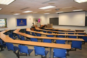 classroom with stationary seating and projector